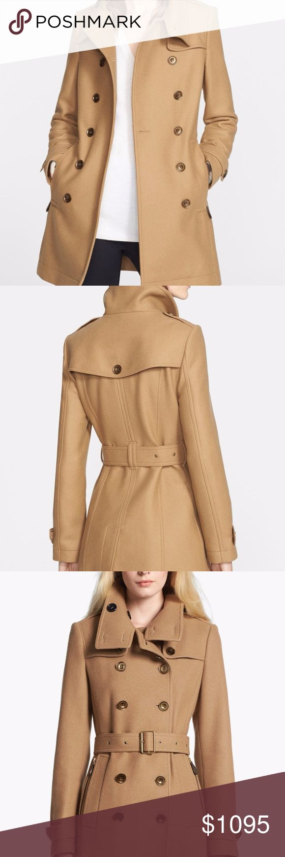 BURBERRY DAYLESMOORE SHORT DOUBLE WOOL TWILL COAT Includes Garment Bag/Proof of Purchase/Burberry Extra Buttons/Burberry Tags A cold-weather classic from Burberry, this wool-blend coat features an impeccably tailored double-breasted silhouette with a belt that cinches the waist for streamlined sophistication. Stand collar with button closure, button epaulettes Long sleeves with button tab cuffs, chest button gun flaps Double-breasted front button closure, front zip and flap pockets…