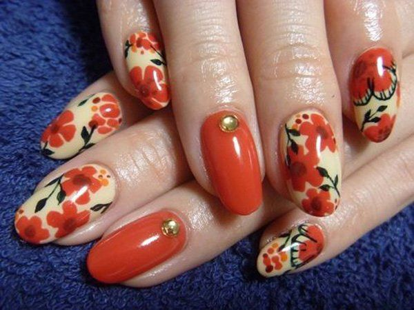 Another vintage flower concept design, but what makes this different from the other one is how the flowers stand out from the nails. Smooth and exciting strokes of petals and leaves grace the nails as they are coupled with golden beads. The melon shades give an impression of a person who is fresh and loves to have fun.