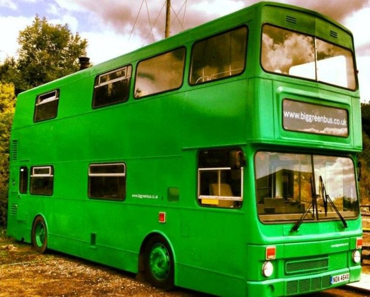 The Big Green Bus is a retired city bus renovated into a mini traveling hotel!