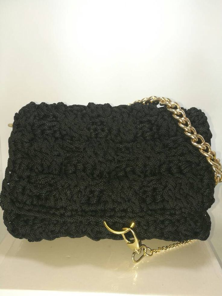A personal favourite from my Etsy shop https://www.etsy.com/listing/486718494/womens-black-handbag-with-gold-chain-and