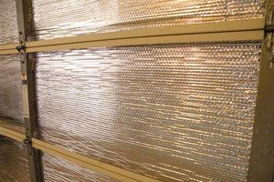 Keep your Garage quiet and energy efficient with an easy DIY Garage Door insulation project.  #HouseLogic