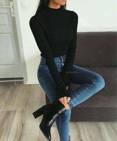 Simple black turtleneck and high-waisted jeans.
