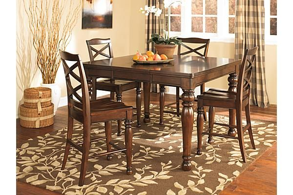 the porter counter height dining room table from ashley furniture homestore the warm. Black Bedroom Furniture Sets. Home Design Ideas