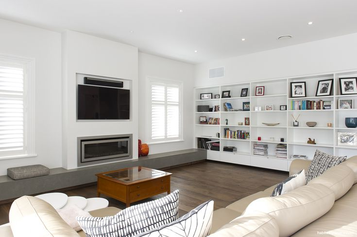 The light and airy main living room is a much-used space, and finished in Resene Sea Fog walls with a Resene Half Sea Fog ceiling and Resene Quarter Sea Fog ...