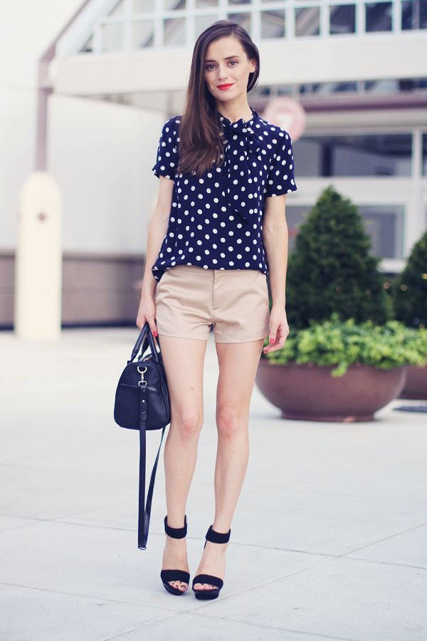 Fashion Click blogger Elena of Classy  Fabulous is polished and ladylike in a bow-adorned polka dot top and preppy khakis shorts.