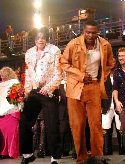 Michael Jackson and Chris Tucker on stage at Madison Square Garden during Michael's 30th Anniversary celebration      Dec 23, 2012 12:17 am