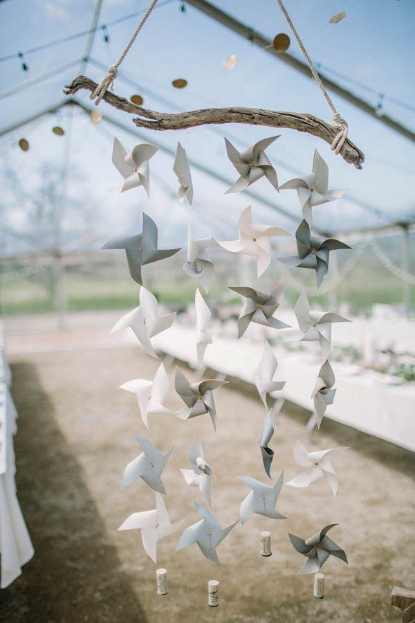 Gray ombre paper windmills hanging from reclaimed wood | Image by Hanna Photography