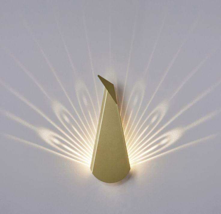 modern light fixtures turn into animals when illuminated