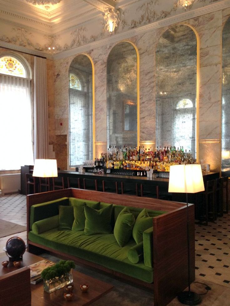 christian liaigre olive green sofa in the lobby of the edition hotel London