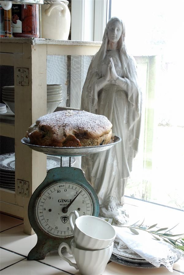 Mary, scale, and bread. Mother, judgement, and nourishment of life.