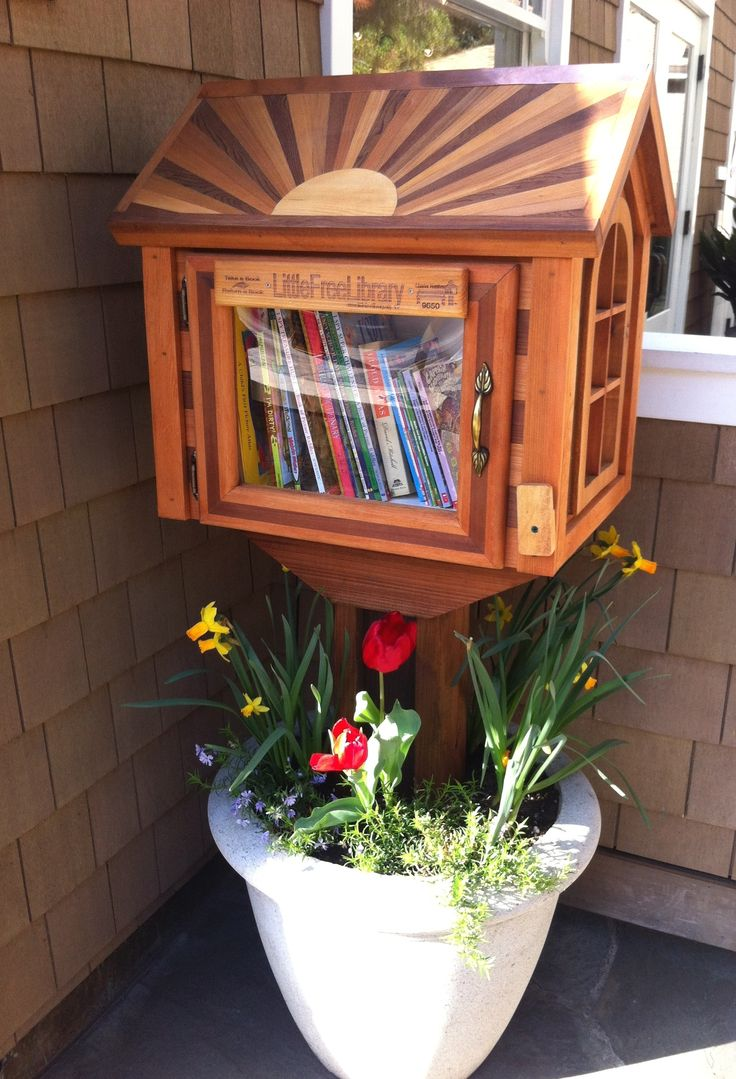 Cedar Sunrise Library - Little Free Library I like the idea of it being in a pot, then it is portable!!