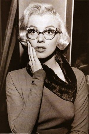 Marilyn Monroe with her vintage cat-eye glasses