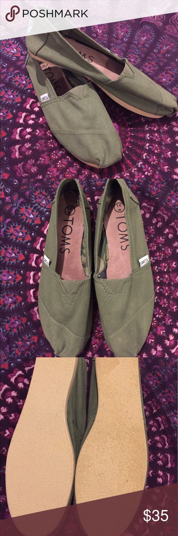 TOMS 1st Edition Olive Camo Canvas Slip-on Shoes These were purchased when TOMS first launched their shoes. Never been worn and have been in storage for years. These are a size 10 but they seem small for a 10 and they're a little narrow for my feet. They have camouflage print inside. TOMS Shoes Flats & Loafers