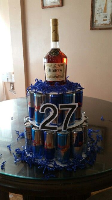 Hennessy cake I made. Perfect for anyone who doesn't like real cake   Material 12 / 10 / 8 inch cake boards 24 redbulls Blue fringe Numbers printed on cardstock   a small hennessy bottle  And your done!