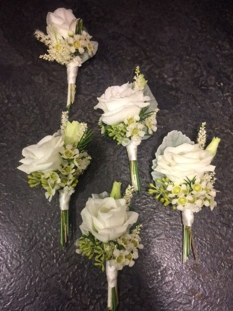 Boutonnieres: White Lisianthus, Eucalyptus with berries, Silver leaf, neatly ties with satin ribbon.