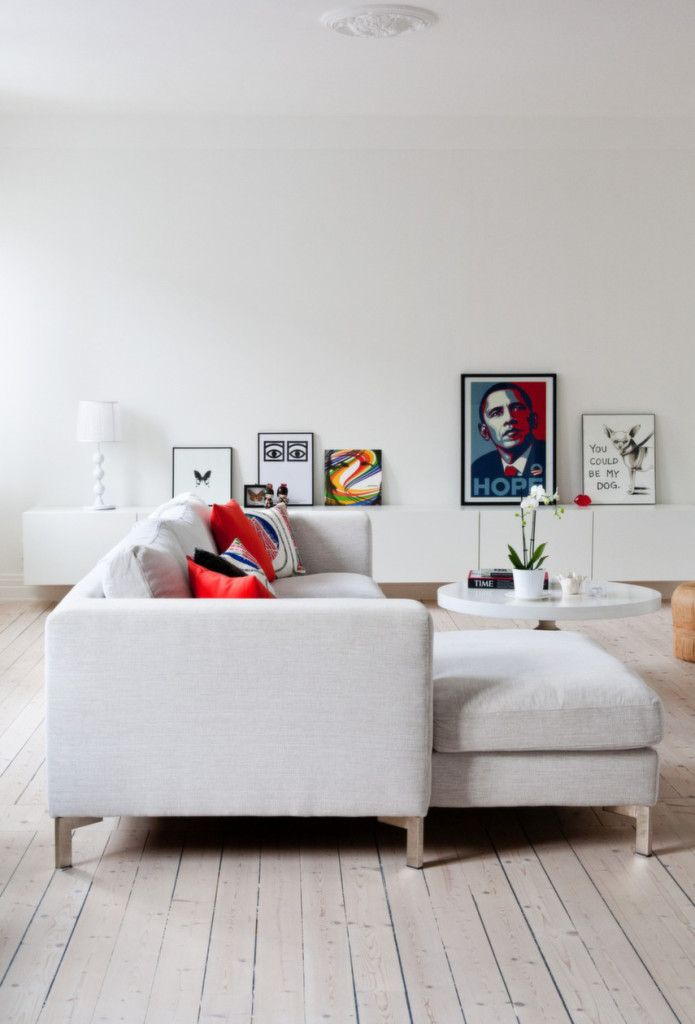 Interior:Comfortable White Living Room Interior Design Styles With White Sofas Also White Red Cushions Tih Round Table Also White Table Lamp Also Barack Obama Painting On White Wall Also Abstract Painting With Wooden Flooring Interior Design Trends 2014 - Top 100 Collections Of White Interior Design Ideas Inspiring