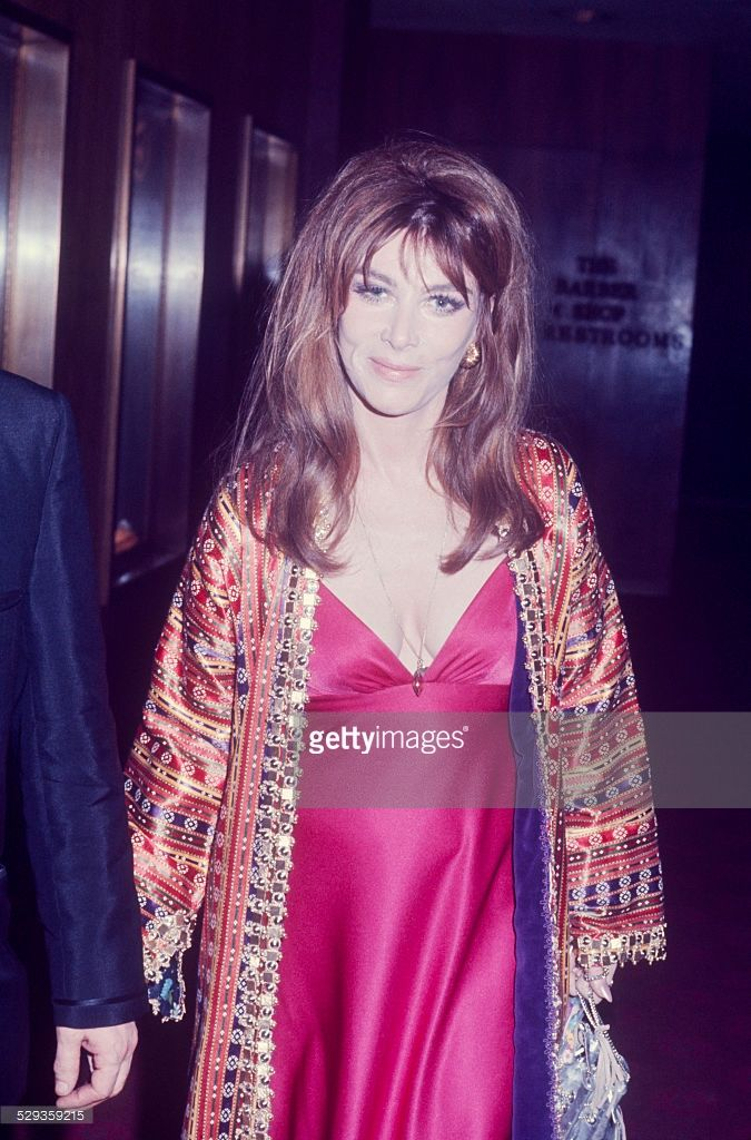 Lee Grant wearing a fuchsia sheath and a brocade evening coat; circa 1970; New York.