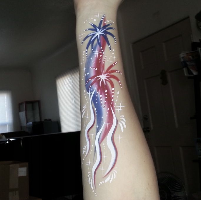 Fireworks 4th of July Patriotic arm painting by Glitter Goose! face paint painter red white and blue flag stars