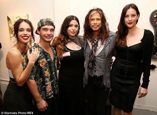 Reunited! Chelsea - born Tallarico - enjoyed a family reunion with brother Taj, the former American Idol judge, and half-sister Liv back in December at Mia's 'Kink' exhibit in Miami
