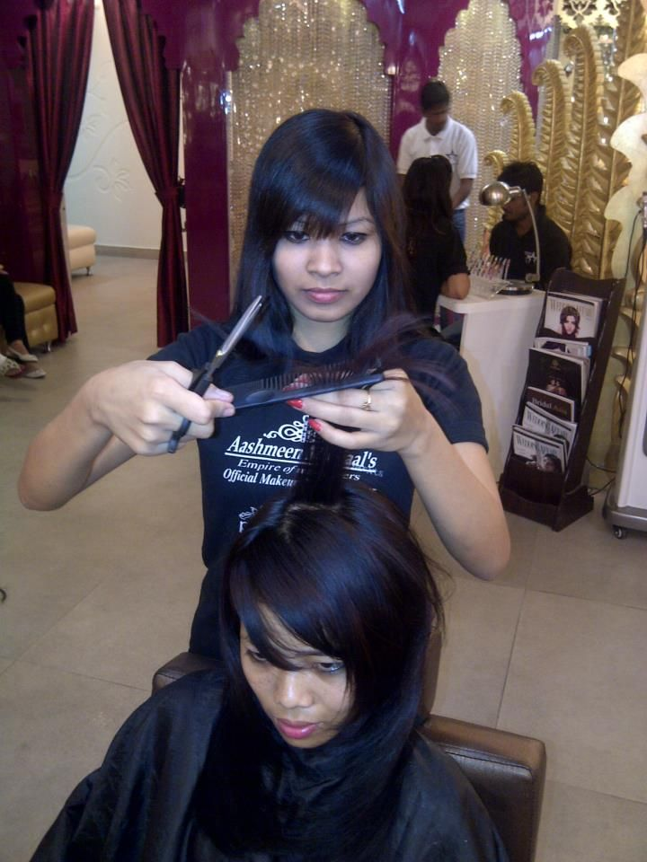 STAR ACADEMY.....STUDENTS GETTING PERFECTION IN HAIR-CUTTING.[an intern giving clipper edge cut on model] , Enroll now