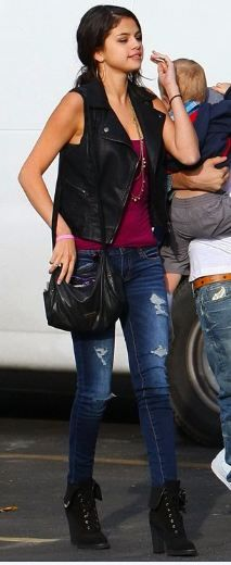 Selena Gomez - black leather vest