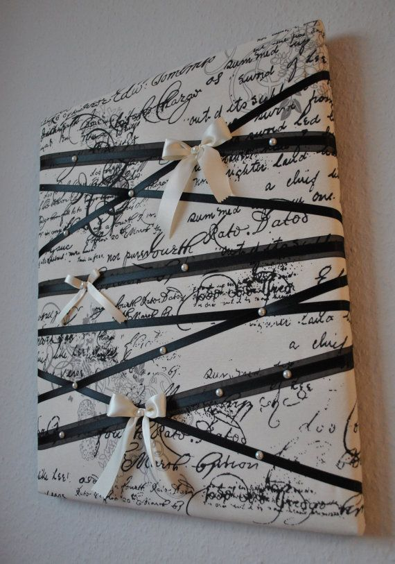 This romantic memo board can easily double as unique wall decor. Made of off-white cotton fabric with black script, black satin ribbon, organza ribbon, off-white satin ribbon and faux pearls. Size: 16in wide x 20in tall This item is made to order and it takes about 1-2 weeks to