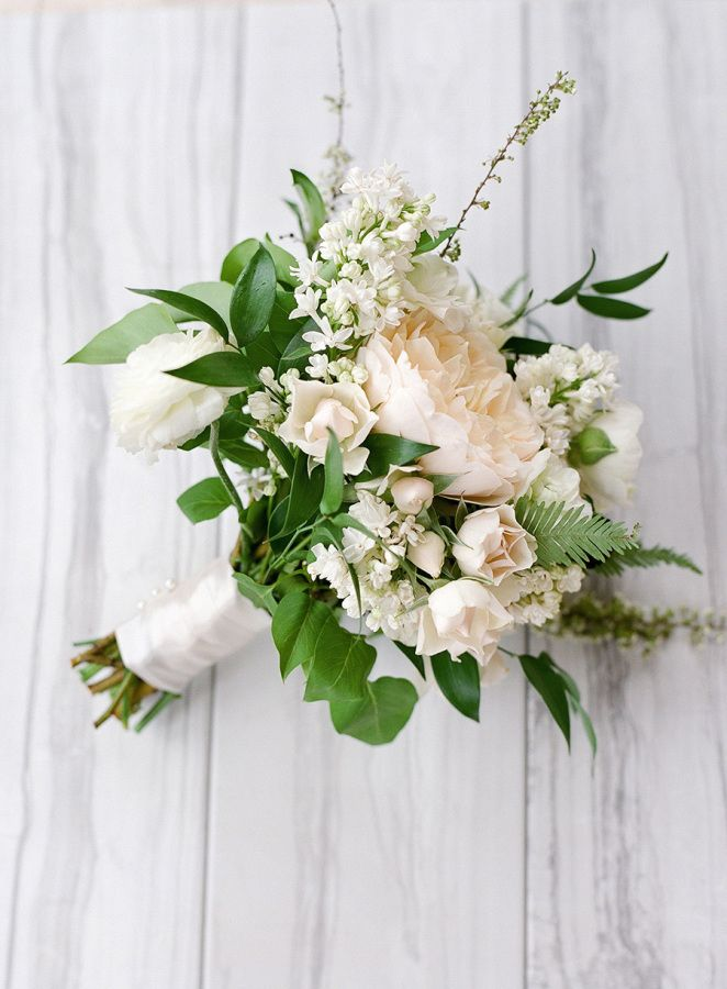 Organic ivory wedding bouquet: http://www.stylemepretty.com/2017/02/06/a-wedding-that-gives-rustic-a-fresh-modern-twist/ Photography: Lacie Hansen - http://laciehansen.com/