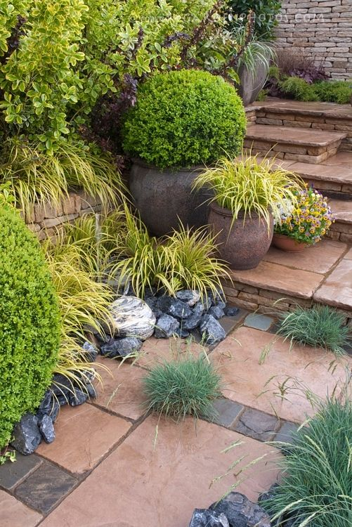 Like the stonework and pavers...grass accents are great too