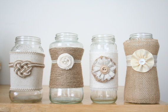 12 Large jars decorated with lace, burlap, twine, and buttons. Perfect for wildflowers or sparkling tea lights, these would make a great addition to