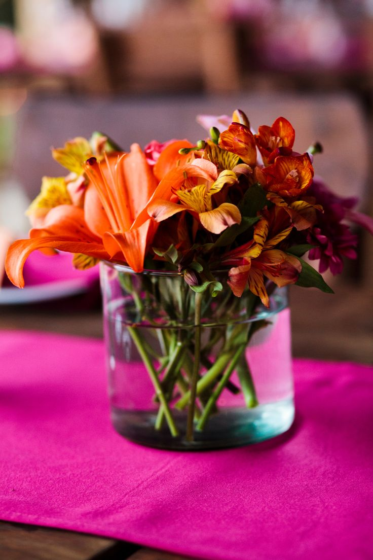 Pink Fiusha And Exotic Flower Mix For The Centerpieces