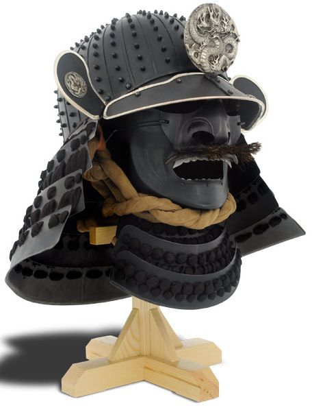 The original of the kabuto (helmet) of the Dragon Armour is interesting inasmuch as the bowl of the helmet came from the Momoyama period. The suji bachi style of bowl, with overlapped and riveted plates was typical of the finest helmet makers (katchu-shi) of this period, borne out by the signature of the Saotome smith ''Ienao'' on the back plate. The menpo (mask) is a typical ressei men of the type made in Nara.