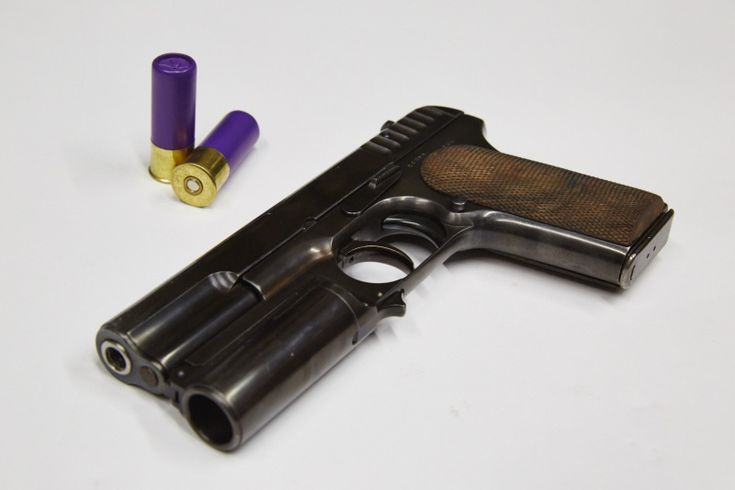 KingsmanPistol a modified Russian Tokarev TT-30 pistol. The prop master added a shotgun barrel. Made by Cohort Film Services in Amersham, United Kingdom  https://www.intellihub.com/wp-content/uploads/2015/02/kingsman-image.jpg  http://www.heroprop.com/wp-content/uploads/2015/09/Kingsman-lancelot-pistol-wallpaper-1024x576.jpg