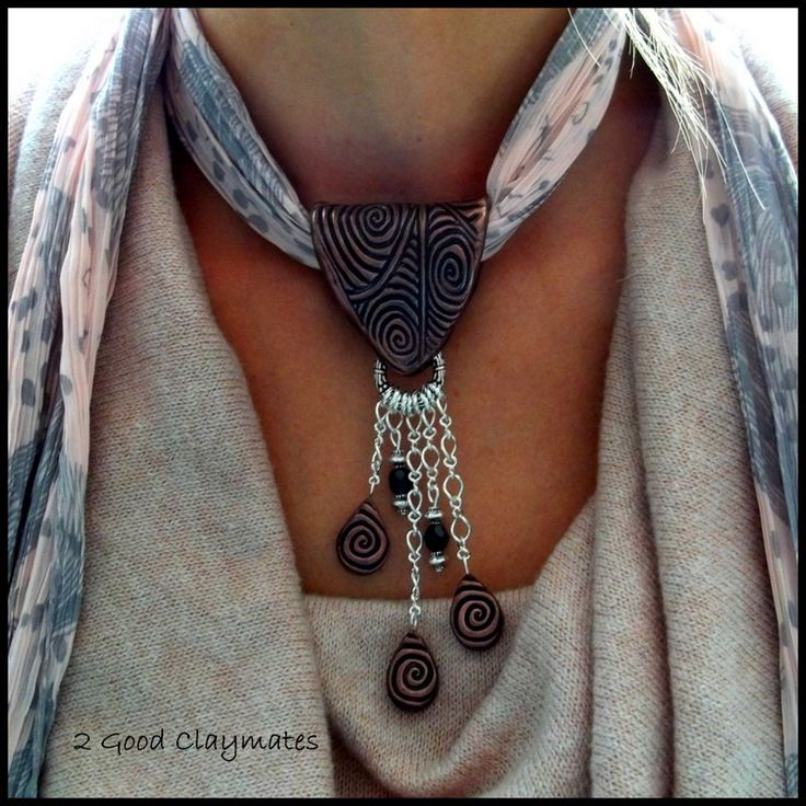 What a lovely way to wear a scarf!Make your own 'clasp' then thread the scarf through it. Necklace/scarf combo.