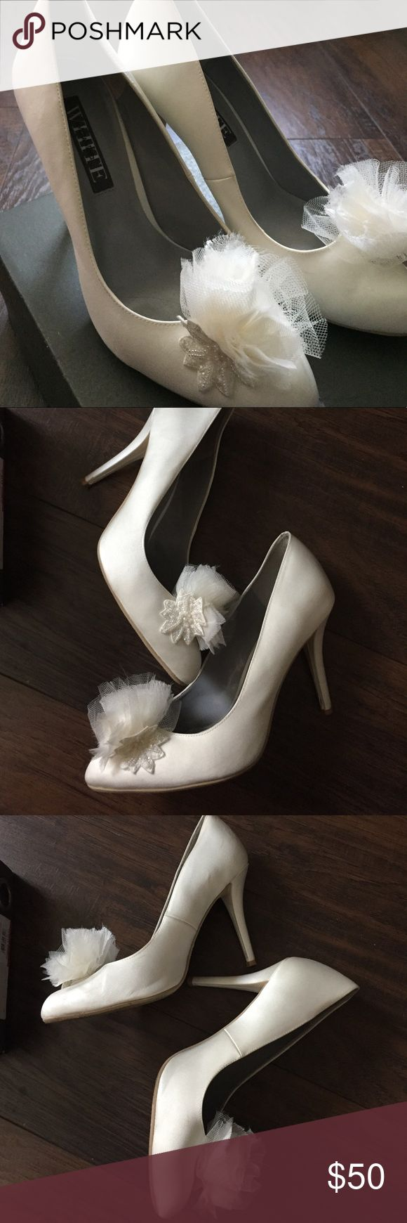 "Vera Wang Ivory Heels White by Vera Wang Collection. 4"" Heels in ivory satin very reminiscent of Carrie Bradshaw. Slight smudges (pictures and priced accordingly). Wore them on my wedding for a few hours. Hate to see them go but they're just sitting in my closet. Vera Wang Shoes Heels"