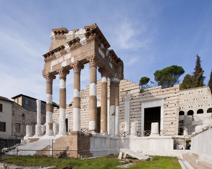 The temple was built by Vespasian between 73 and 74 A.D., as the partly restored dedicatory inscription on the pediment shows, and used to some extent the plan of the Republican sanctuary beneath it, which may be dated early first century B.C. The capitolium site had a terrace on three sides with the temple in the middle and two lateral rows of arcades stretching down towards the Forum.