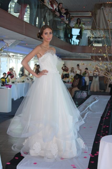 Alma on the runway wearing Sarah Jassir