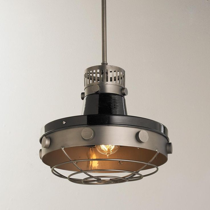 Bolted industrial warehouse pendant the large round bolts and bottom cage add to the authentic look a great look for restaurants and commercial spaces