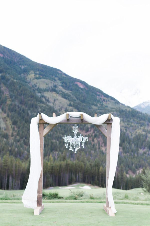 married on a mountain // chanderlier // wedding ceremony backdrop // arbour