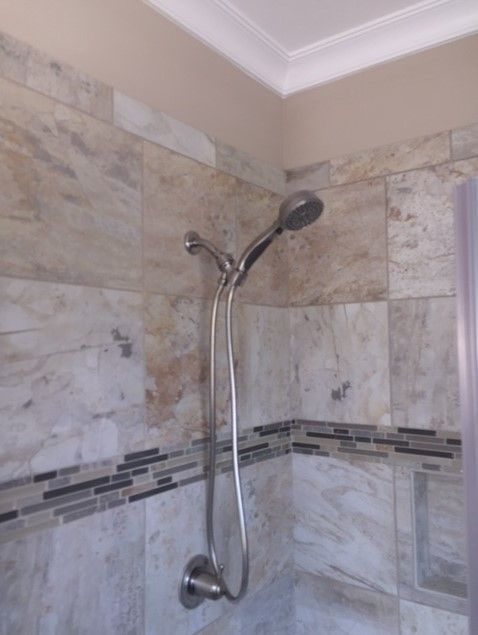 Custom tile installed for this walk in shower in the master bathroom