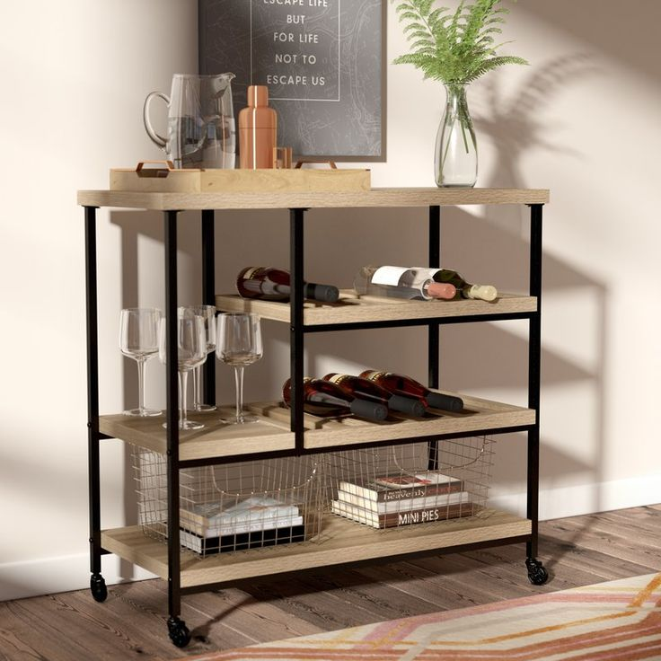 Effortlessly stage your display and bring simple storage to your space with this essential kitchen cart, the perfect balance of understated organization and low-key style. Featuring four tiers of wood shelving in a Sonoma oak finish, this design brings a subtly rustic touch to your aesthetic, while its black-finished metal frame offers a clean-lined, loft-worthy twist to the environment. Use its middle two shelves to keep your favourite vintages at the ready in the dining room, then utilize…