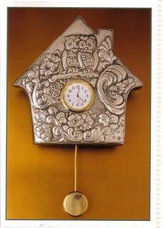 clock repujado