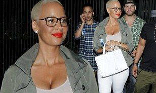 Amber Rose isn't afraid to have a little fun on her own. The 30-year-old singer left her boys - husband Wiz Khalifa and son Sebastain, aged one - at home on Sunday night and rocked out at the Rose Bowl in Pasadena. The Never Again singer enjoyed a summer night out at the Beyoncé and Jay Z's On the Run concert in Los Angeles.