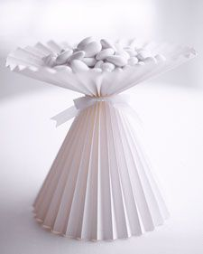 Martha Stewart Weddings, Volume 6 1998 Dragees have a long history at weddings, and a paper compote at the center of each table lets your guests be part of the tradition. Construct the compote from a single piece of paper folded accordion-style, and fill with sugar-coated almonds.