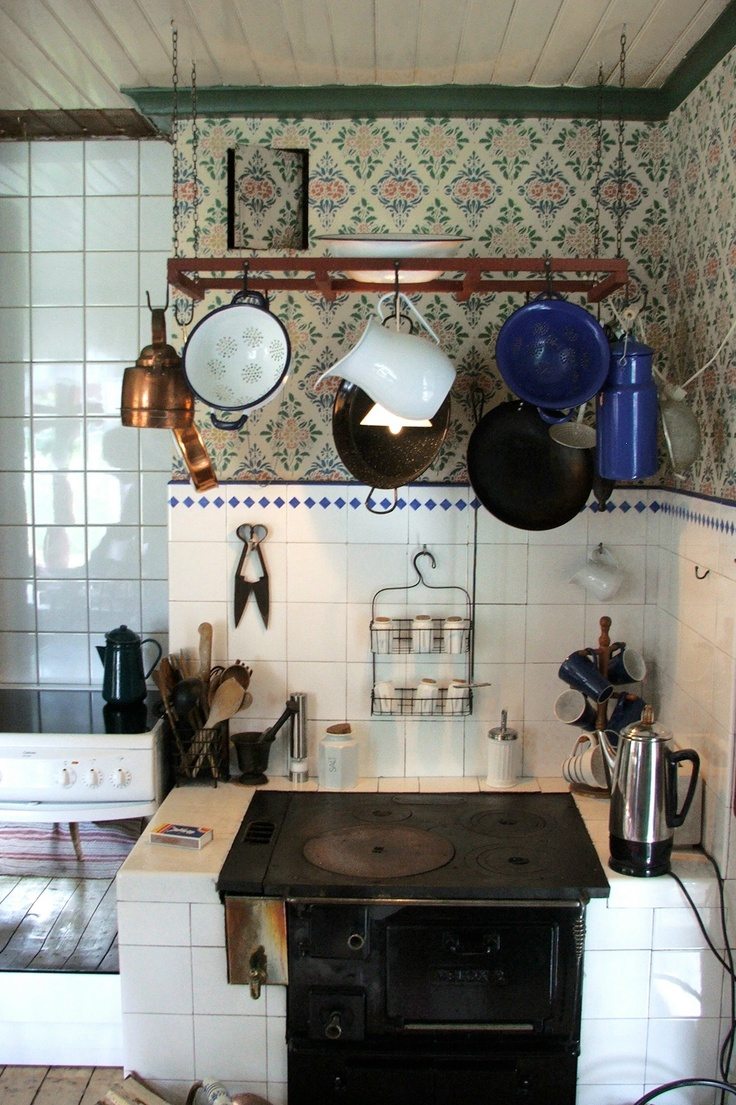 Old stove beside new stove in kitchen in old farmhouse in Sweden