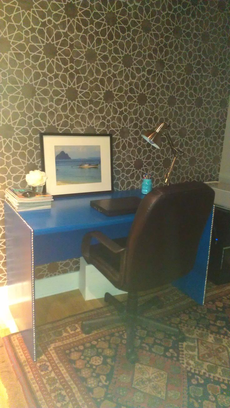 Our office nook, stenciled wall (me), painted desk with nail heads (me), photo in Thailand (yeah me again), antique Persian rug (yeah no way - a wedding gift from my father).