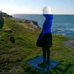 A Translucent Figurative Sculpture Appears Camouflaged Against the Horizon of Bondi Beach