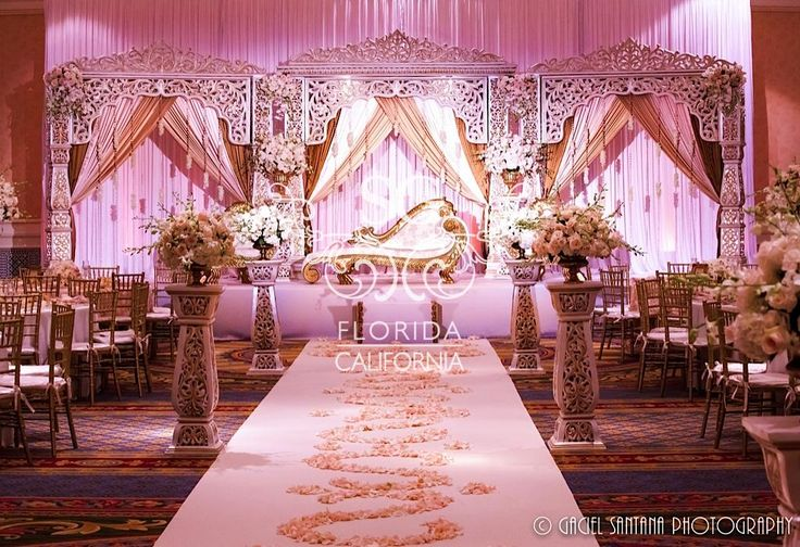 Suhaag Garden, Florida California wedding decorators, white and gold reception stage, wedding aisle