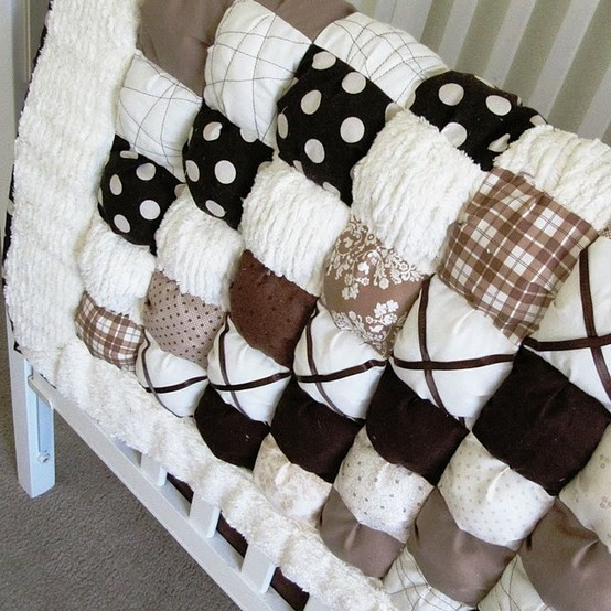 Puffy Quilt.  I think I'm going to make one for baby girl's room.  I'll use vintage chenille and flannel.  It's going to be adorable!!!  I can't wait!