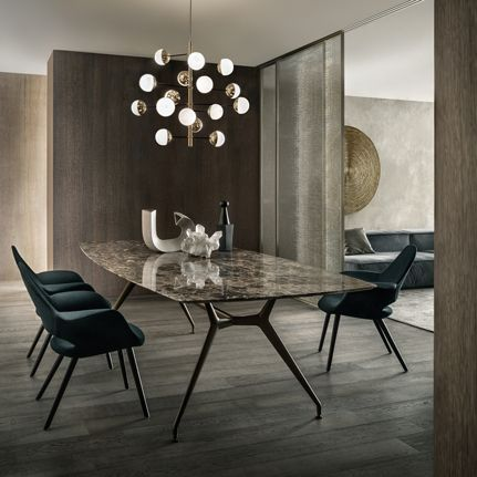 Manta table with brown aluminum structure and emperador marble top. Velaria sliding doors in palladio aluminum and golden mesh glass