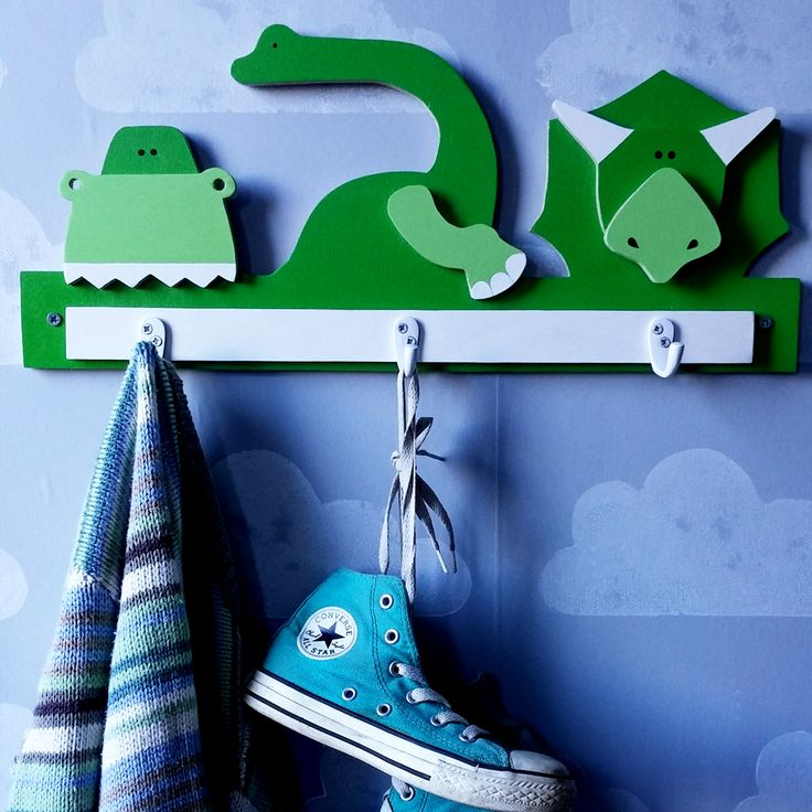 These eco-friendly  dinosaurs scene hooks will add a touch of fun to any child's bedroom decor.   Made of 9 mm birch plywood responsibly sourced, the set comes with 3 single robe hooks and screws directly unto the wall.  DIMENSIONS:  (W) 50cm x (H) 25cm